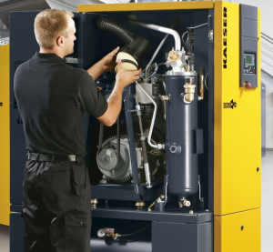 Engineer servicing air compressor