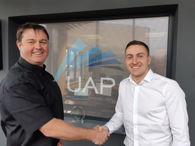 Dean Urmston pictured with Dave Seenan Director at UAP